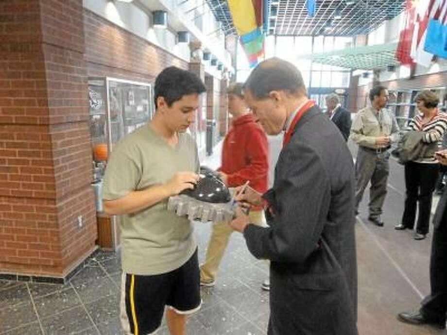 JASON SIEDZIK/ Register Citizen Sen. Richard Blumenthal signs the helmet of a member of the Gearheads, Northwestern Regional High School's FIRST robotics team.