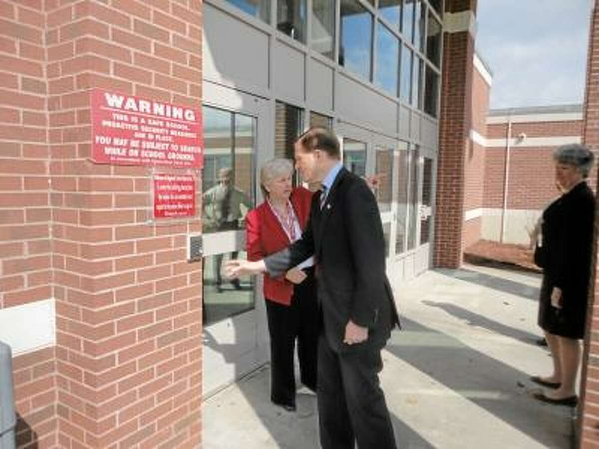 JASON SIEDZIK/ Register Citizen Sen. Richard Blumenthal's tour of Northwestern Regional Middle and High School's security measures started with the buzzer at the front door.