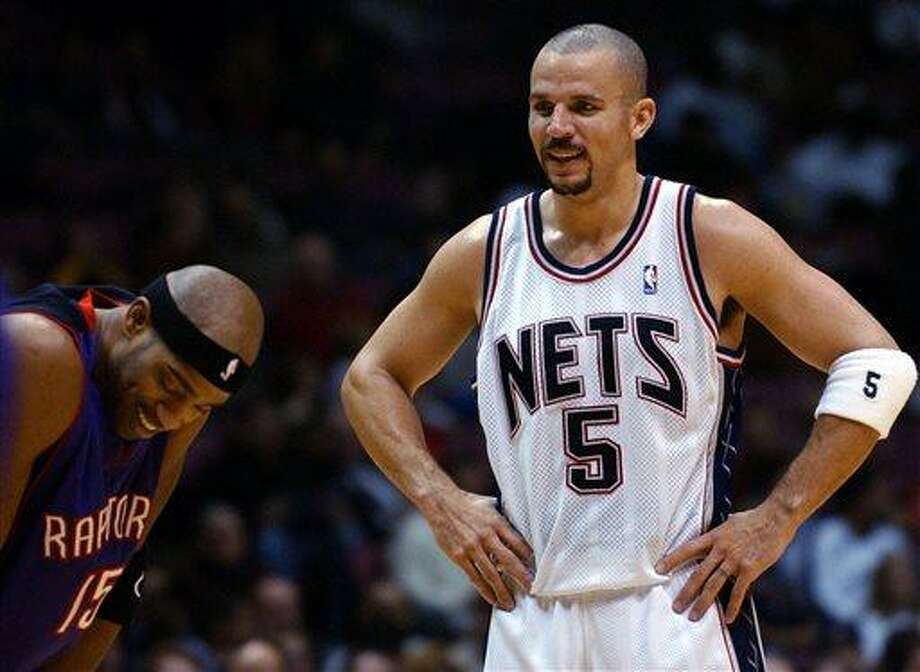 FILE - In this Dec. 6, 2004 file photo, New Jersey Nets' Jason Kidd (5) talks with Toronto Raptors' Vince Carter during the second quarter of an NBA game in East Rutherford, N.J. The New York Knicks say Kidd has decided to retire from the NBA after 19 seasons. His retirement Monday, June 3, 2013,  comes two days after fellow 40-year-old Grant Hill, with whom Kidd shared Rookie of the Year honors in 1995, announced his retirement. (AP Photo/Bill Kostroun, File) Photo: AP / AP