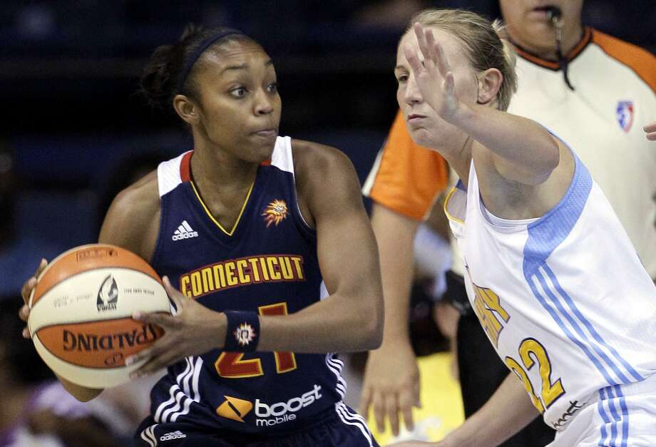 Connecticut Sun guard Renee Montgomery, left, looks to a pass as Chicago Sky guard Courtney Vandersloot defends during the first half of a WNBA basketball game on Friday, July 13, 2012, in Rosemont, Ill. (AP Photo/Nam Y. Huh) Photo: AP / AP