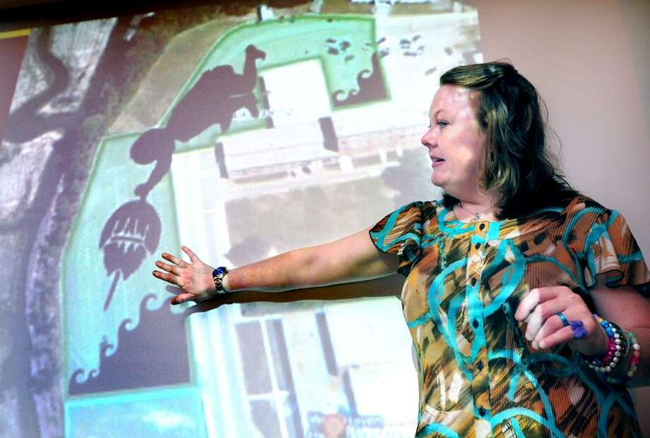 Elinor Slomba, director of the Chalkville project, shows the planned chalk design for the parking lot of West Haven High School on 6/3/2013.  The chalk drawing planned for mid-July will incorporate about 2,000 registered participants for what should be a Guinness World Record for the largest chalk pavement art.Photo by Arnold Gold/New Haven Register  AG0501A