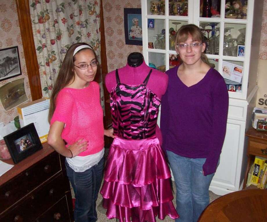 Photo Special to the Dispatch by Mike Jaquays Katherine Scherz, 17, left, and Marissa Scherz, 16, of Verona, pose with the dress Katherine designed for her prom. Katherine will graduate from Vernon-Verona-Sherrill Central School this month, while Marissa is finishing up 10th grade at the school.