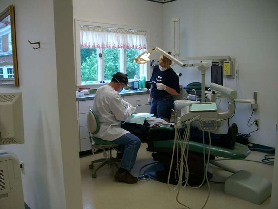 Photo Courtesy Dr. Bruce Stewart Dr. Bruce Stewart and assistant Carrie Jones provide dental care on Dentistry Day last year.