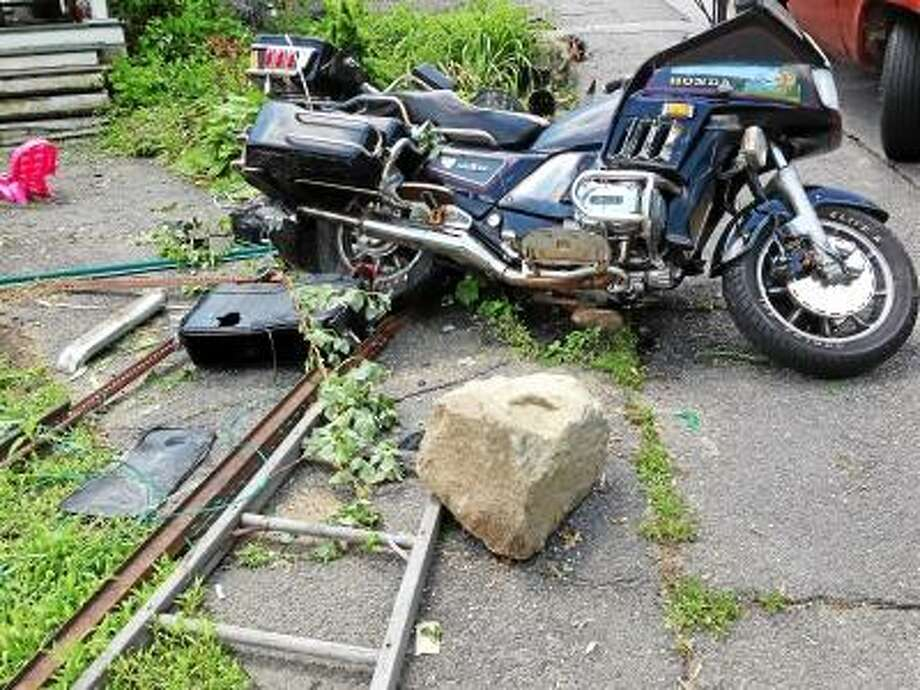 Submitted photo - The Honda motorcycle sustained damage after the hit-and-run at 170 Hinsdale Ave. Monday morning.
