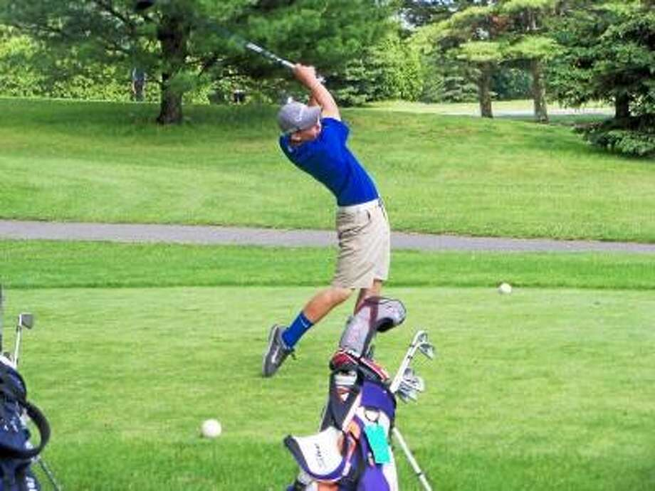 Photo by Peter Wallace/Register Citizen  Lewis Mills' Jordan Gilbert tees off on No. 8 at the Timberlin Golf Club Monday in the Division III State Tournament.
