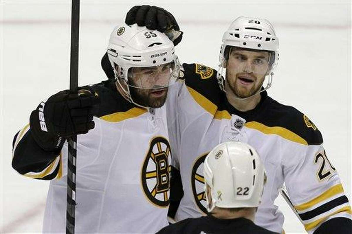 Boston Bruins' Johnny Boychuk (55) celebrates his goal with teammate Daniel Paille (20) in the third period of Game 2 of the NHL hockey Stanley Cup Eastern Conference finals against the Pittsburgh Penguins in Pittsburgh Monday, June 3, 2013. The Bruins won 6-1. (AP Photo/Gene J. Puskar)