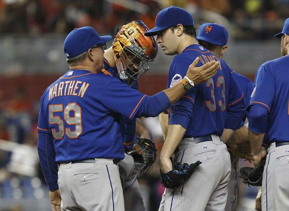 New York Mets pitching coach Dan Warthen (59) talks to starter Matt Harvey (33) during the fifth inning of a baseball game  against the Miami Marlins in Miami, Sunday, June 2, 2013. The Marlins won 11-6.  (AP Photo/J Pat Carter) Photo: AP / AP