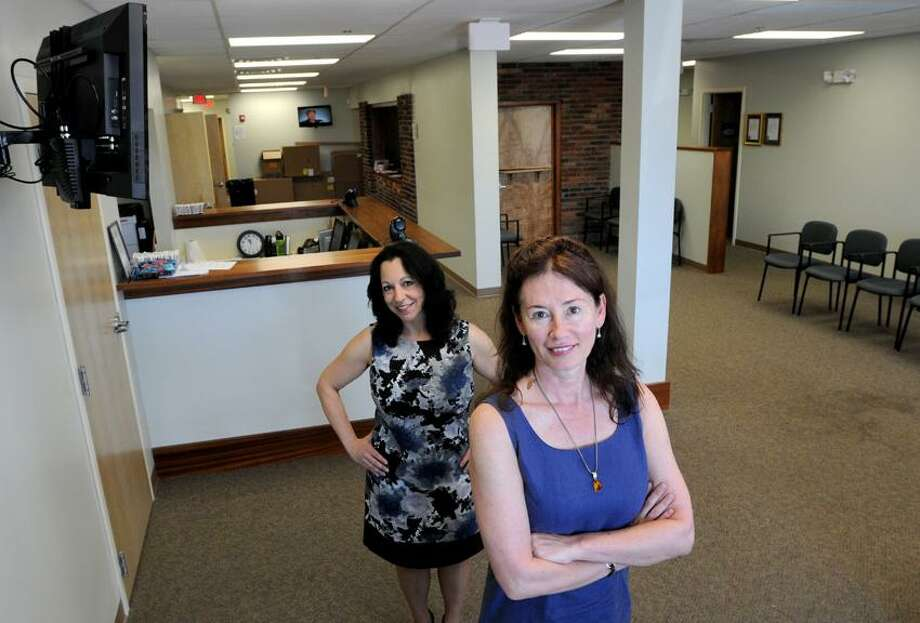 APT Foundation Program Director Kim DiMeola, left, and CEO Lynn Madden, right, at the APT Foundation on State Street in North Haven, Conn. Saturday, June 1, 2013. The APT Foundation is a substance abuse and mental health care treatment facility.  Photo by Peter Hvizdak / New Haven Register Photo: New Haven Register / ©Peter Hvizdak /  New Haven Register