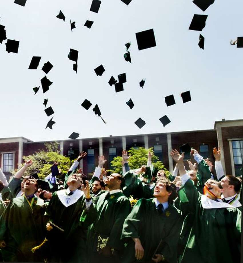 West Haven- Niotre Dame graduates toss their caps  into the air after ceremonies have ended.    Melanie Stengel/Register