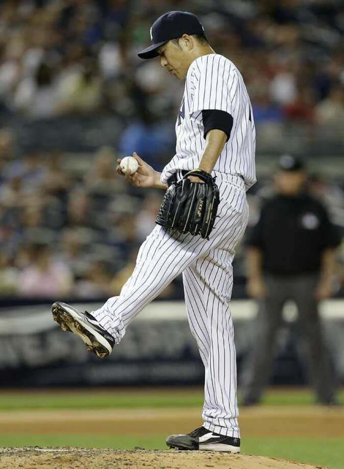 New York Yankees starting pitcher Hiroki Kuroda (18) reacts in the fourth inning of a baseball game against the Boston Red Sox at Yankee Stadium in New York, Sunday, June 2, 2013.  (AP Photo/Kathy Willens) Photo: AP / AP