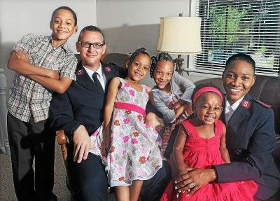 Catherine Avalone/The Middletown Press Captain Shawn Hovatter and his wife, Captain Rene' Hovatter, Commanding Officers for the Salvation Army with their four children, Isaiah, 9, Alexis 4, Brianna, 7 and Olivia, 20 months transferred to Middletown on March 11. The Hovatters were stationed in East Hartford for two years and have spent their last four years in the Virgin Islands before returning to Connecticut. / TheMiddletownPress