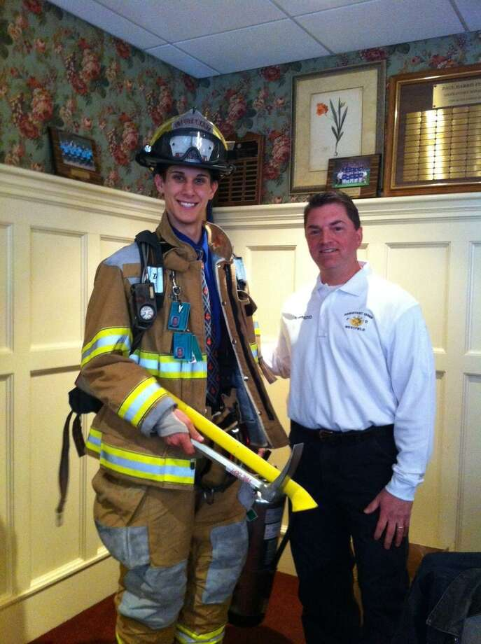 Pictured left to right are Jonathan Grzeszczyk, April Student of the Month, with Lt. Darrell Ponzio of Westfield Fire Department, who spoke to the Middletown Rotary Club on Fire Safety and provided a safety equipment demonstration.