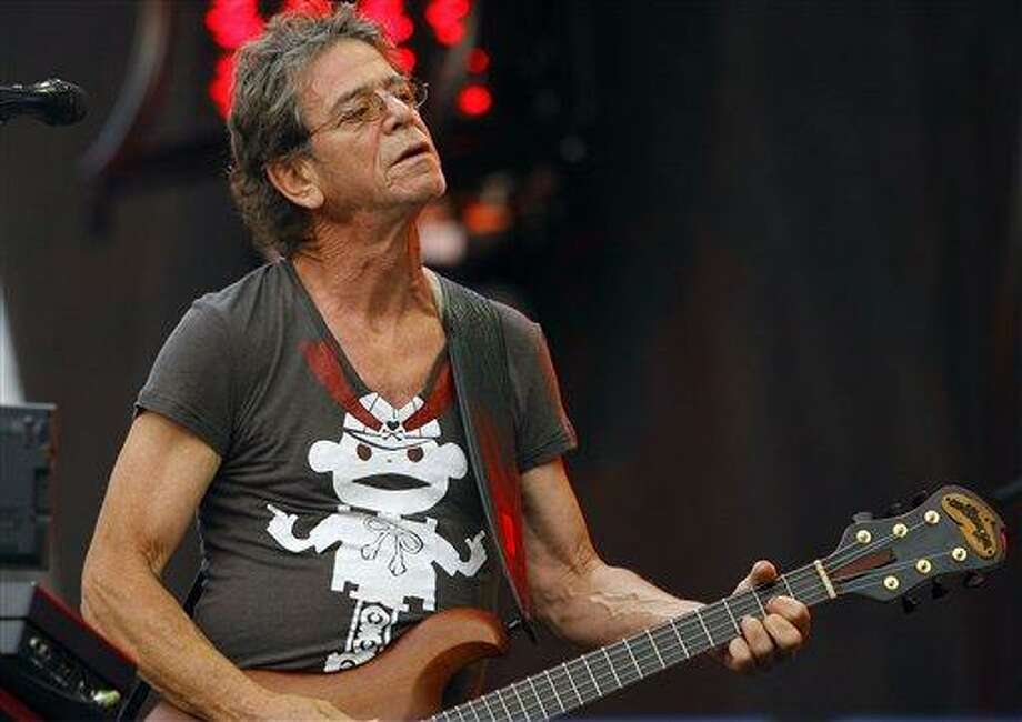 """FILE- In this Sunday, Aug. 9, 2009 file photo, Lou Reed performs at the Lollapalooza music festival, in Chicago. Lou Reed's wife says the rock icon is recovering after a life-saving liver transplant, according to an interview published Saturday, June 1, 2013,  in a British newspaper. Laurie Anderson told the Times of London that Reed """"was dying"""" before the operation in April at Ohio's Cleveland Clinic. (AP Photo/John Smierciak, File) Photo: AP / FR170074 AP"""
