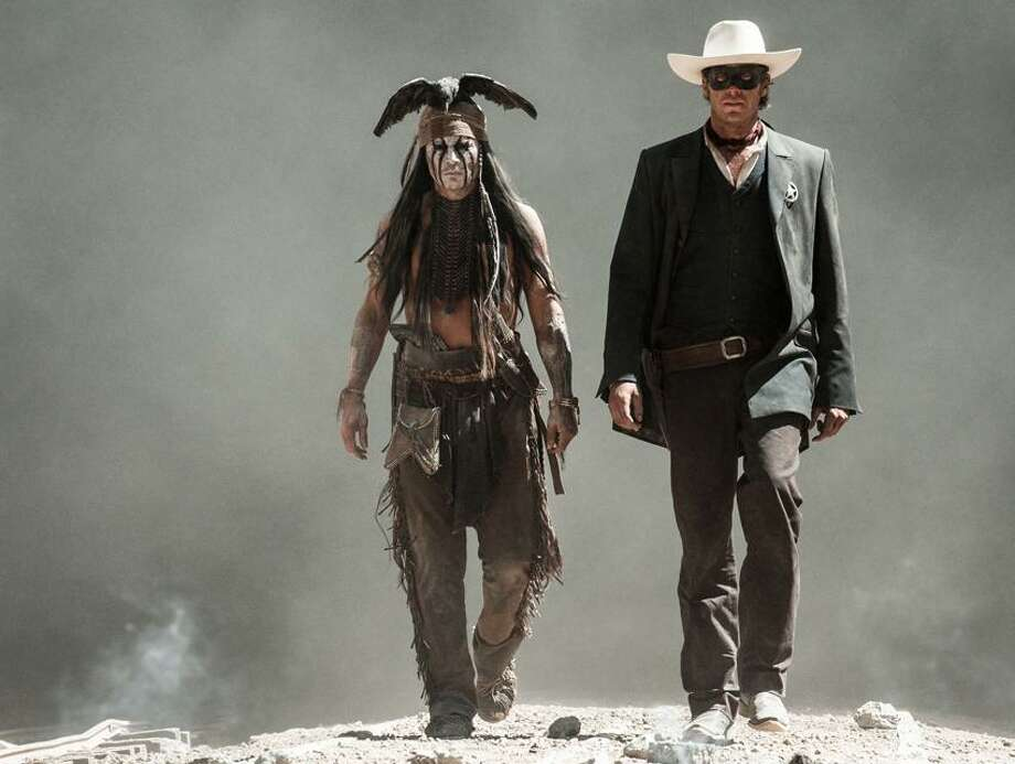 """Warner Bros. Pictures: Johnny Depp is Tonto and Armie Hammer is """"The Lone Ranger in the film due July 3."""