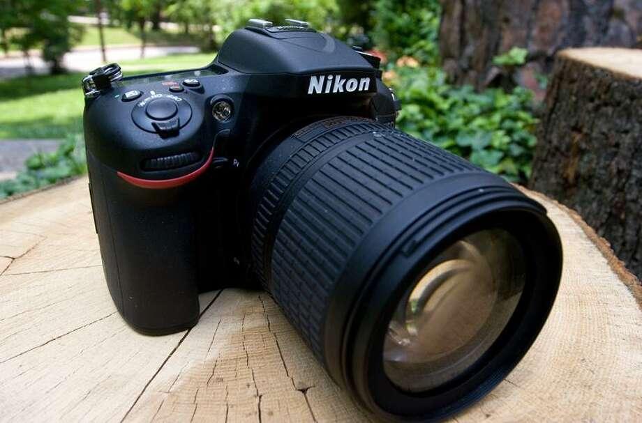 Associated Press: Nikon's D7100 camera is a 24-megapixel DSLR that can shoot high-definition video. Photo: AP / AP2013