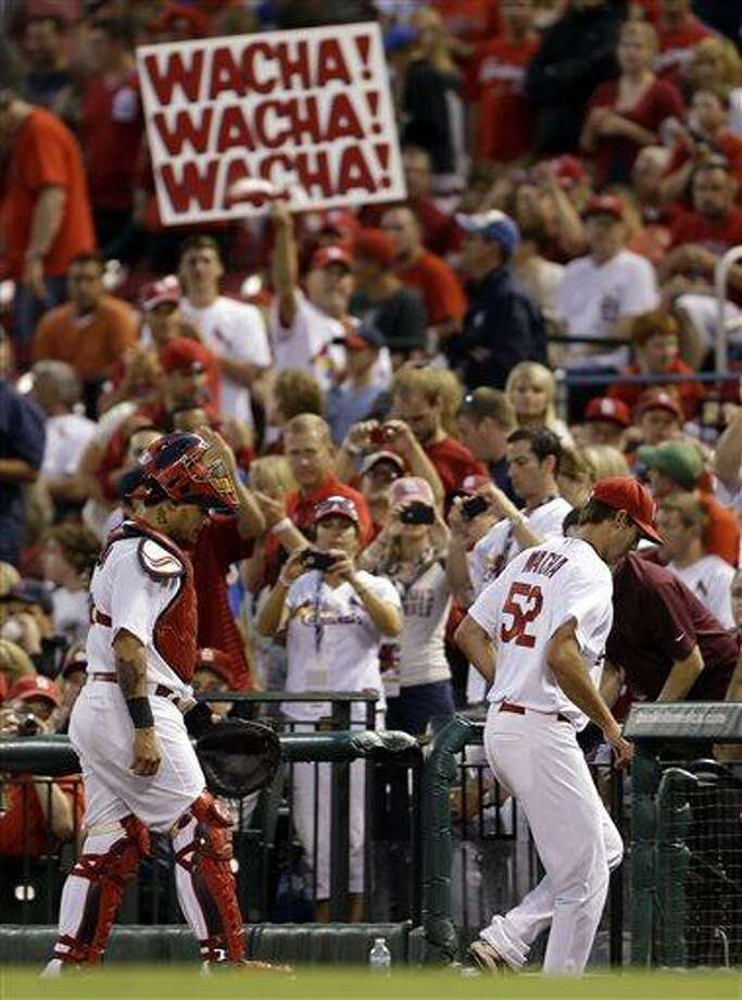 St. Louis Cardinals starting pitcher Michael Wacha, right, walks into the dugout alongside catcher Yadier Molina after warming up before a baseball game against the Kansas City Royals, Thursday, May 30, 2013, in St. Louis. The game was Wacha's major league debut. (AP Photo/Jeff Roberson) Photo: AP / AP
