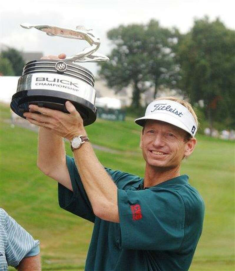 Brad Faxon raises the trophy after winning the Buick Championship in Cromwell on Sunday Aug. 28, 2005. Faxon birdied the first playoff hole on 18 to win, and shot a final-round 61 to tie the course record. (Associated Press)