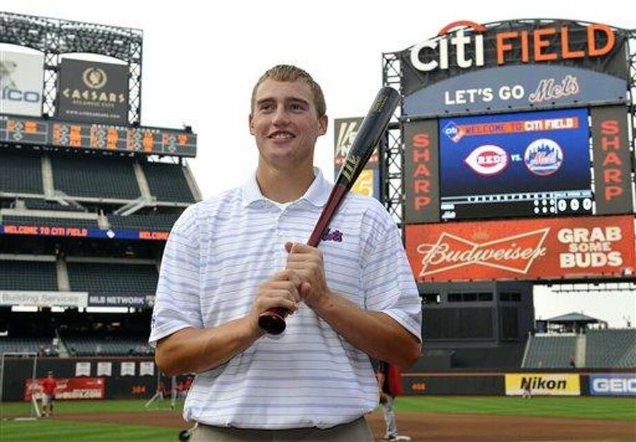 Brandon Nimmo, the New York Mets' first-round draft pick from 2011, stands on the field before the baseball game between the Mets and the Cincinnati Reds on Monday, Sept. 26, 2011, in New York. (AP Photo/Kathy Kmonicek) Photo: AP / FR170189 AP