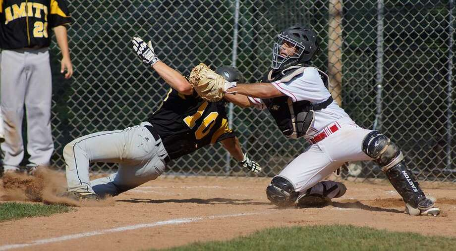 """Greenwich-- Amity's Keith Klebart was called out on this play at the plate as Greenwich's Jonathan Dreher tries to makes the tag during the 3rd inning. Class LL quarterfinal action. Photo-Peter Casolino/Register <a href=""""mailto:pcasolino@newhavenregister.com"""">pcasolino@newhavenregister.com</a>"""