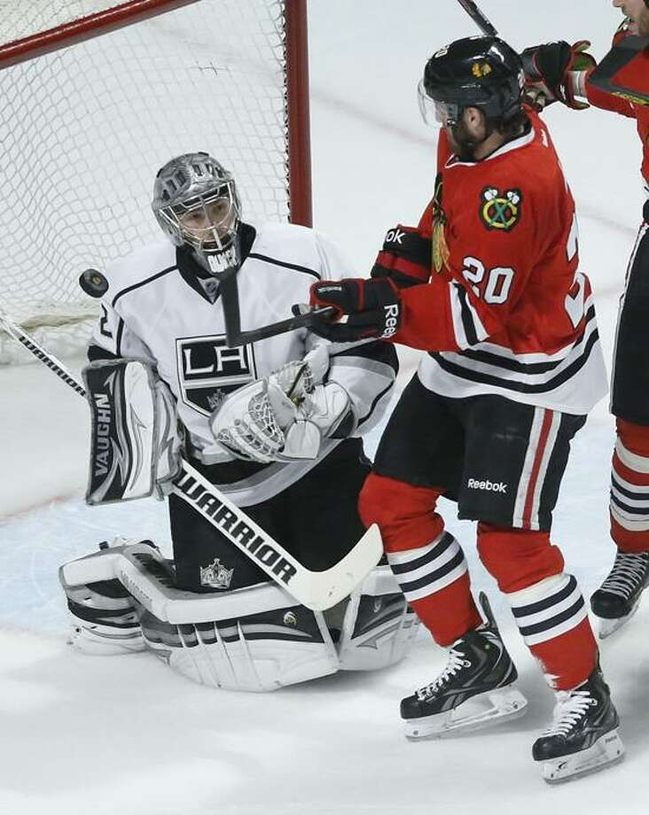 Los Angeles Kings goalie Jonathan Quick (32) blocks a shot by Chicago Blackhawks left wing Brandon Saad (20) during the first period in Game 1 of the NHL hockey Stanley Cup Western Conference finals Saturday, June 1, 2013, in Chicago. (AP Photo/Charles Rex Arbogast) Photo: AP / AP