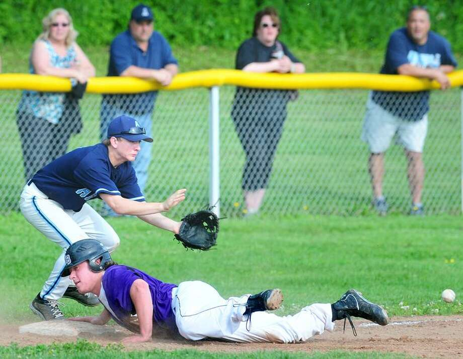 Marty Mikos (left) of Ansonia waits for the ball as Kyle Hart (right) of North Branford slides safely into third base in the sixth inning on 5/29/2013.Photo by Arnold Gold/New Haven Register   AG0500C