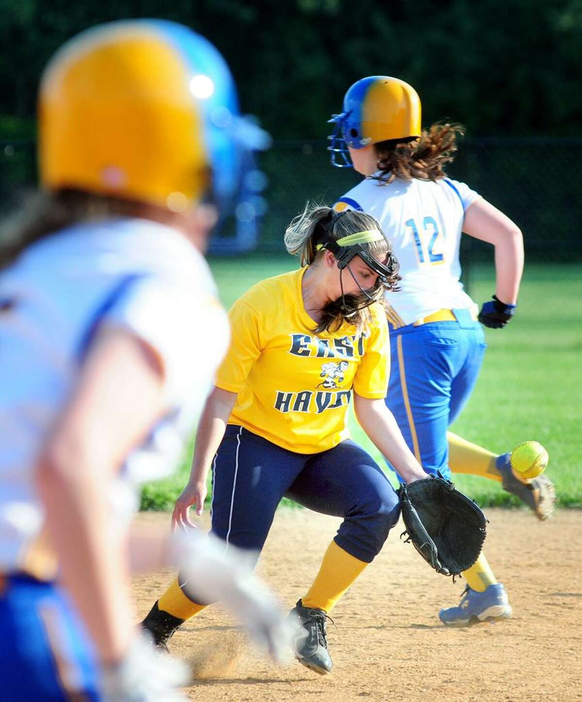 Alyssa Apuzzo (center) of East Haven reaches for the ball after misplaying a grounder against Seymour in the sixth inning of their Class M quarterfinal on 5/31/2013.Photo by Arnold Gold/New Haven Register