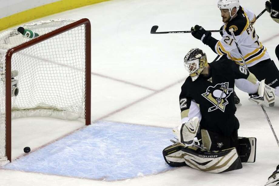 Pittsburgh Penguins goalie Tomas Vokoun (92) watches as a shot by Boston Bruins' David Krejci (46), not shown, gets past him for a goal in the first period of Game 1 of the NHL hockey Stanley Cup Eastern Conference finals in Pittsburgh Saturday, June 1, 2013. (AP Photo/Gene J. Puskar) Photo: AP / AP