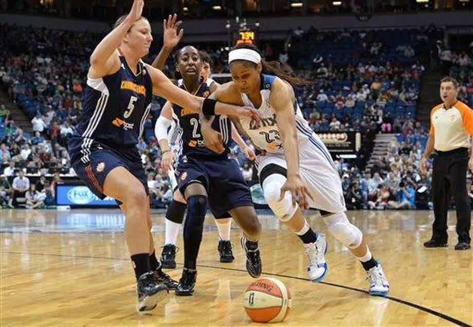 Minnesota Lynx forward Maya Moore, front right, rushes past Connecticut Sun's Kelsey Griffin (5) and Allison Hightower on her way to the net during the first quarter of a WNBA basketball game on Saturday, June 1, 2013, at the Target Center in Minneapolis. (AP Photo/Bre McGee) Photo: AP / FR170691 AP