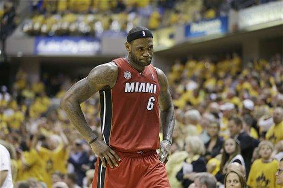 Miami Heat forward LeBron James reacts during the second half of Game 6 of the NBA Eastern Conference basketball finals against the Indiana Pacers in Indianapolis, Saturday, June 1, 2013. Pacers won 91-77. (AP Photo/Michael Conroy) Photo: AP / AP