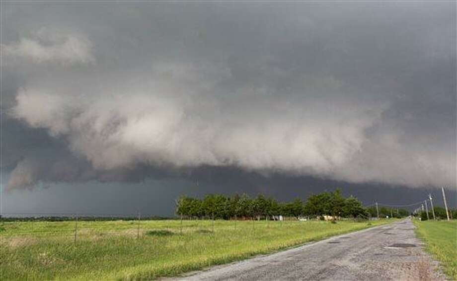 A tornado forms near Banner Road and Praire Circle in El Reno, Okla. on Friday, May 31, 2013. (AP Photo/Alonzo Adams) Photo: AP / FR159426 AP