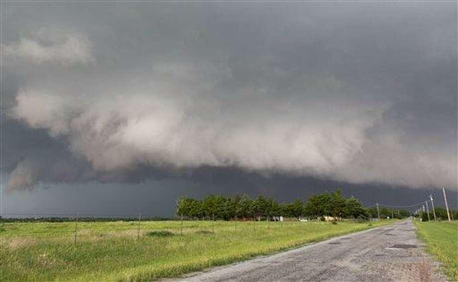 A tornado forms near Banner Road and Praire Circle in El Reno, Okla. on Friday, May 31, 2013. (AP Photo/Alonzo Adams) Photo: AP / FR159426 AP