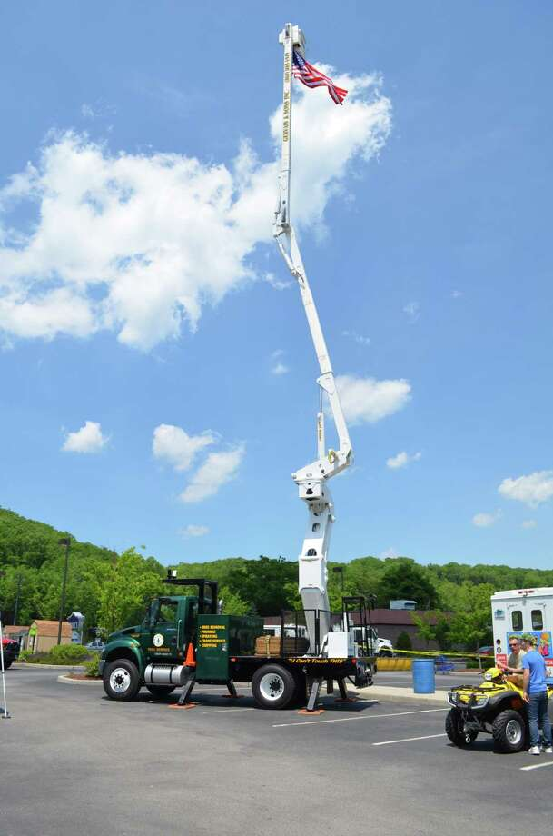 Kate Hartman/Register Citizen. Brett Simmons, superintendent of Parks and Recreation, said the bucket truck was a hit at Magic Motion.