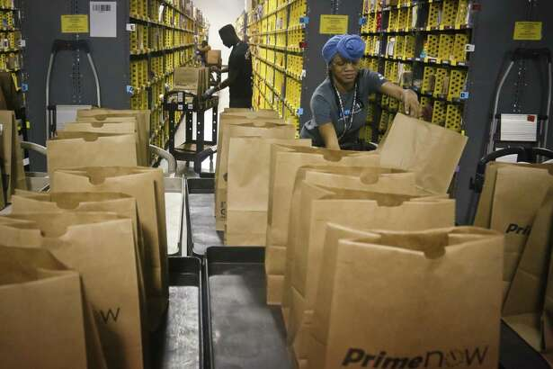 Amazon is scheduling a massive job fair at multiple sites nationally on Aug. 2, 2017, hoping to fill many of its 50,000 open jobs. (AP Photo/Bebeto Matthews, File)