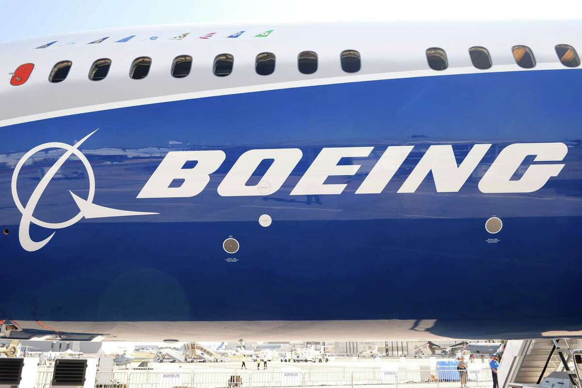 This file photo taken on June 18, 2017 shows the Boeing logo on the fuselage of a Boeing 787-10 Dreamliner test plane presented on the Tarmac of Le Bourget on the eve of the opening of the International Paris Air Show. Boeing reported better-than-expected quarterly earnings on July 26, 2017 and lifted its full-year profit forecast, citing a strong operational performance and tax savings not anticipated earlier in the year. Net income in the second quarter was $1.8 billion, up from the $234 million loss in the year-ago period due to one-time costs on its military and commercial aircraft programs.
