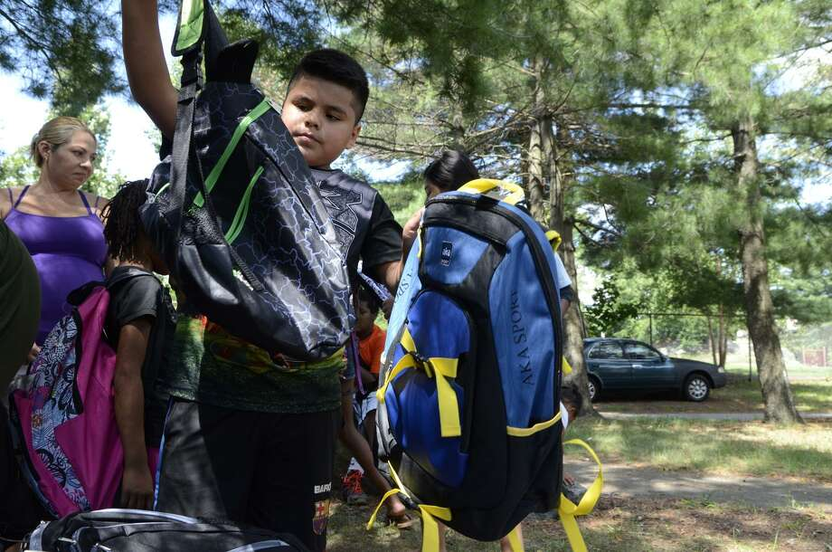 The Norwalk Fire Department is collecting backpacks and schools supplies for the Norwalk Human Services Council. Photo: Shelley Cryan / For Hearst Connecticut Media / Norwalk Hour Freelance