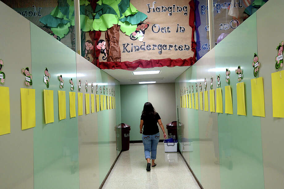 "Kindergarten teacher Paula Ryder makes her way to her classroom as she and fellow teachers and staff at Taft Elementary prepare for the upcoming school season. Taft is among the eleven District 5 ""Districts of Innovation"" schools that will be starting earlier than the August 28 general state school start.  Photo taken Tuesday, July, 25, 2017 Kim Brent/The Enterprise Photo: Kim Brent / BEN"