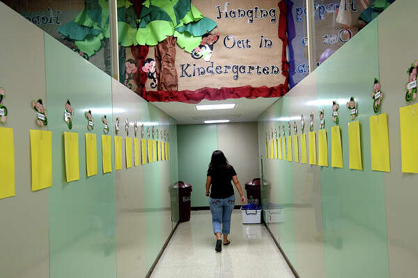 """Kindergarten teacher Paula Ryder makes her way to her classroom as she and fellow teachers and staff at Taft Elementary prepare for the upcoming school season. Taft is among the eleven District 5 """"Districts of Innovation"""" schools that will be starting earlier than the August 28 general state school start.  Photo taken Tuesday, July, 25, 2017 Kim Brent/The Enterprise"""