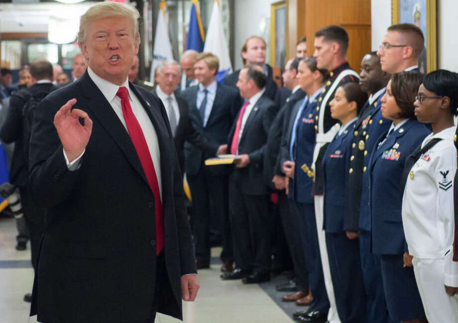 US President Donald Trump made an announcement on twitter Wednesday saying he would bar transgender people from serving in the military. Click through to see what he said... Photo: AFP Contributor/AFP/Getty Images