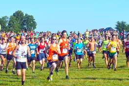 Runners participate in the 21st running of Mud Mountain on the SIUE cross country course last year. The event is a fundraiser for the EHS and middle school cross country program.