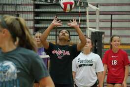 Seleste Harris participates in a hitting drill during Pearland summer volleyball camp Tuesday, Jul. 25.