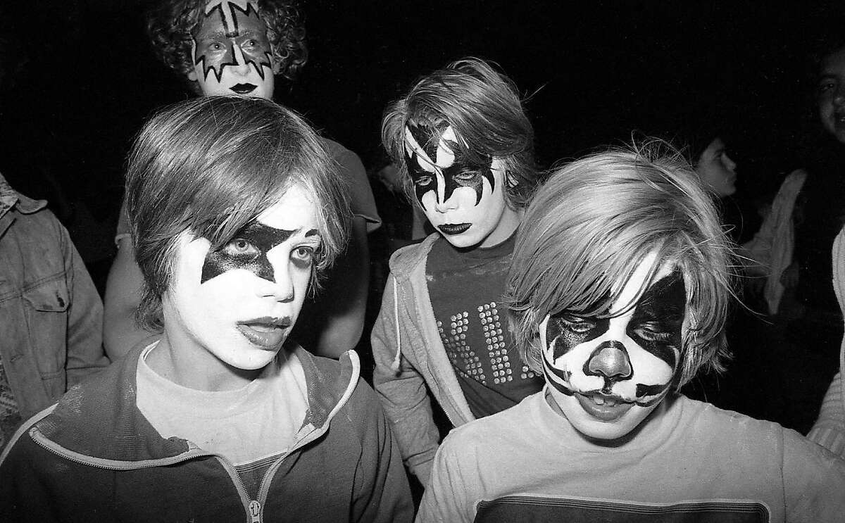 """Young fans in makeup enjoy the KISS concert at the Cow Palace on Aug. 16, 1977. The band was at their peak popularity, and it was the night Elvis Presley died. KISS played """"Jailhouse Rock"""" as a tribute."""