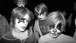 "Aug. 16, 1977: Young fans in makeup enjoy the KISS concert at the Cow Palace. The band was at their peak popularity, and it was the night Elvis Presley died. KISS played ""Jailhouse Rock"" as a tribute."
