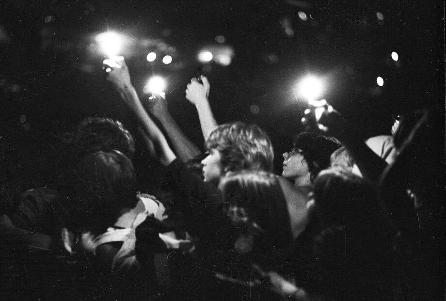 Fans support the band KISS with lighters in the air during an Aug. 16, 1977 concert at the Cow Palace. Photo: Stephanie Maze, The Chronicle