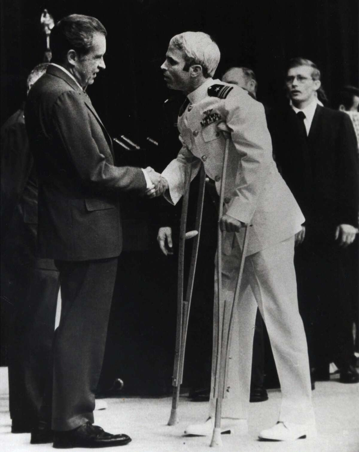 John McCain is greeted by President Richard Nixon, left, in Washington in the spring of 1973 after being released following more than five years in a Vietnamese prisoner of war camp. (AP Photo/file)