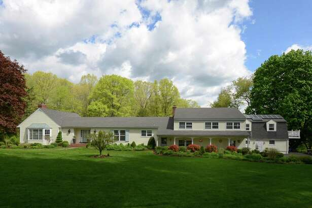 The rambling cream-colored clapboard colonial ranch at 100 Drum Hill Road has 4,475 square feet of living and entertaining space on a 2.5-acre park-like property.