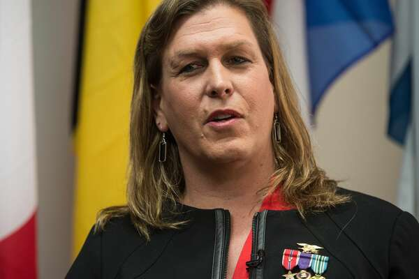 "Transgender former US Navy Seal Senior Chief Kristin Beck speaks during a conference entitled ""Perspectives on Transgender Military Service from Around the Globe"" organized by the American Civil Liberties Union (ACLU) and the Palm Center in Washington on October 20, 2014. Transgender military personnel from 18 countries who allow them to serve openly,  gathered to talk about their experiences and discuss whether the US military could join them.   AFP PHOTO/Nicholas KAMM        (Photo credit should read NICHOLAS KAMM/AFP/Getty Images)"