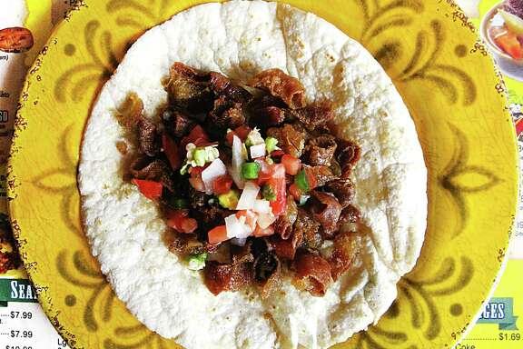 Crispy tripas taco with pico de gallo on a handmade corn tortilla from Taco Jalisco.