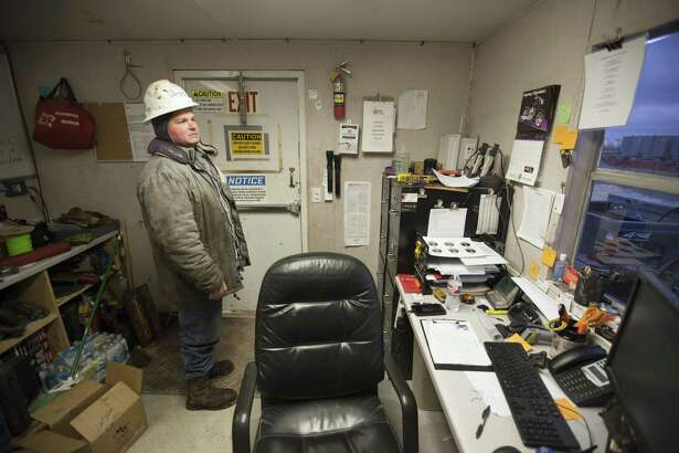 Randy Perry, a crew manager who oversees drilling for Elevation Resources, at his office near Midland, Texas, Jan. 14, 2015. With oil prices plummeting by more than 50 percent since June, the gleeful mood of recent years has turned glum here in West Texas as the frenzy of shale oil drilling has come to a screeching halt