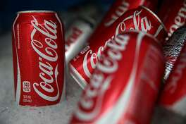FILE - JULY 26, 2017: It was reported that Coca-Cola profited $9.702 billion in the second quarter, topping analysts' expectations July 26, 2017 SAN FRANCISCO, CA - JULY 22:  Cans of Coca Cola are displayed in a food truck's cooler on July 22, 2014 in San Francisco, California. The San Francisco Board of Supervisors will vote on Tuesday to place a measure on the November ballot for a 2-cents-per-ounce soda tax. If the measure passes in the November election, tax proceeds would help finance nutrition, health, disease prevention and recreation programs.  (Photo by Justin Sullivan/Getty Images)