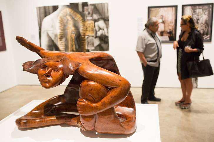 """""""Tijerina,"""" a sculpture of a woman sitting cross-legged carved from a mesquite log by San Antonio-based artist Jose Rivera, is one of the works in """"Icons and Symbols of the Borderland,"""" an exhibit at Centro de Artes."""